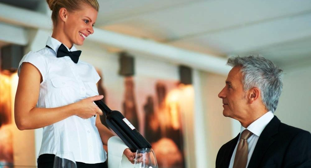waitress-serving-a-bottle-of-wine.jpg